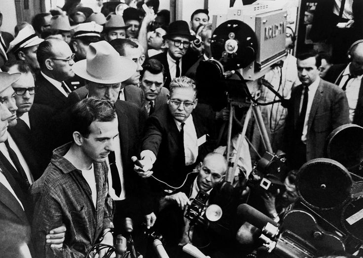 Thomas J Kelley during Lee Oswald's press ocnference